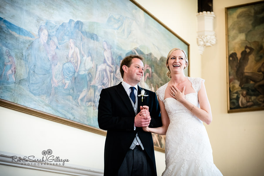 Bride and groom give speech inside Big School at Malvern College