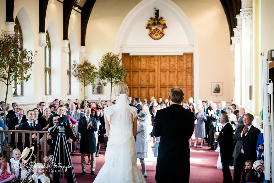 Bride and groom give speech inside Malvern College