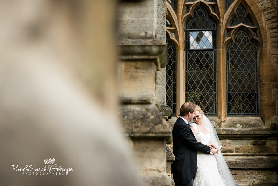 Bride and groom share moment together outside Malvern College