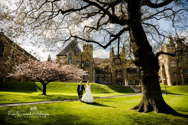 Bride and groom in grounds at Malvern College