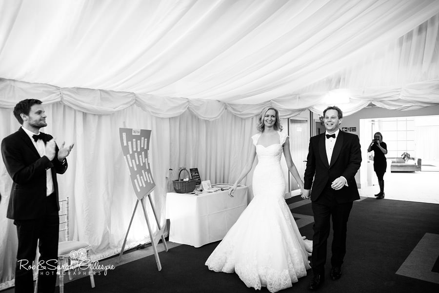 Bride and groom enter Gryphon Room for wedding breakfast