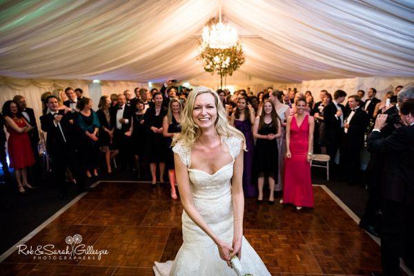Bride throws bouquet at Malvern College wedding