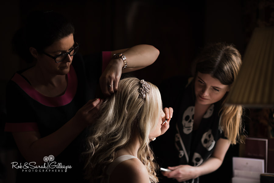Bride having hair and makeup done at Coombe Abbey
