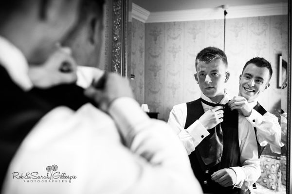 Groom gets ready for wedding at Coombe Abbey
