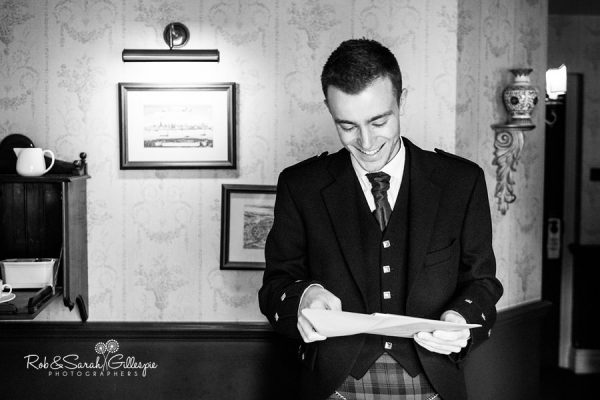 Grooms reads message from bride at Coombe Abbey