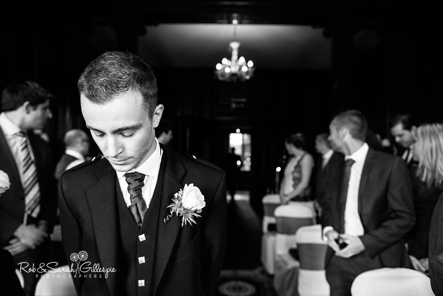 Groom looking nervous before wedding ceremony at Coombe Abbey