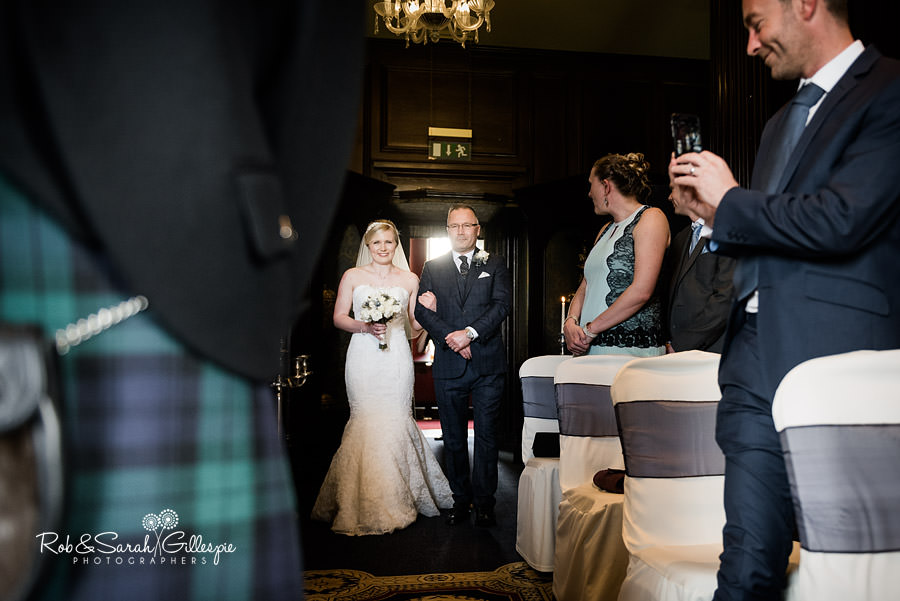 Bride makes her entrance at Coombe Abbey wedding ceremony