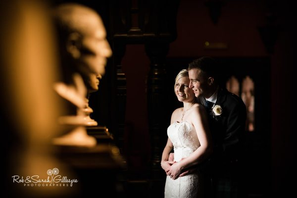 Bride and groom at Coombe Abbey with statues