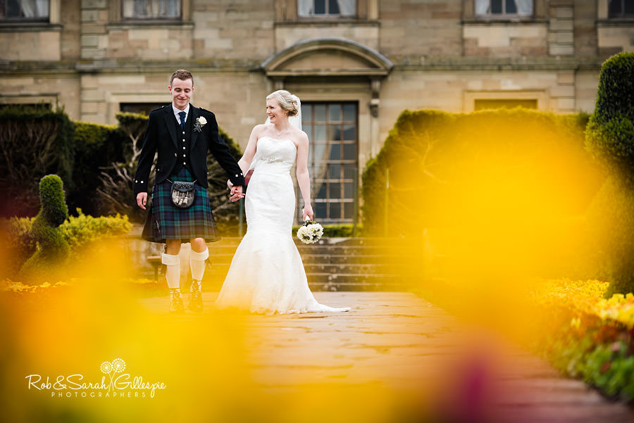 Bride and groom in Coombe Abbey grounds