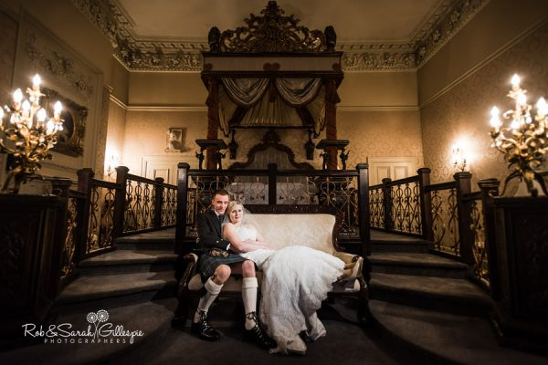Bride and groom in Lady Craven Suite at Coombe Abbeu