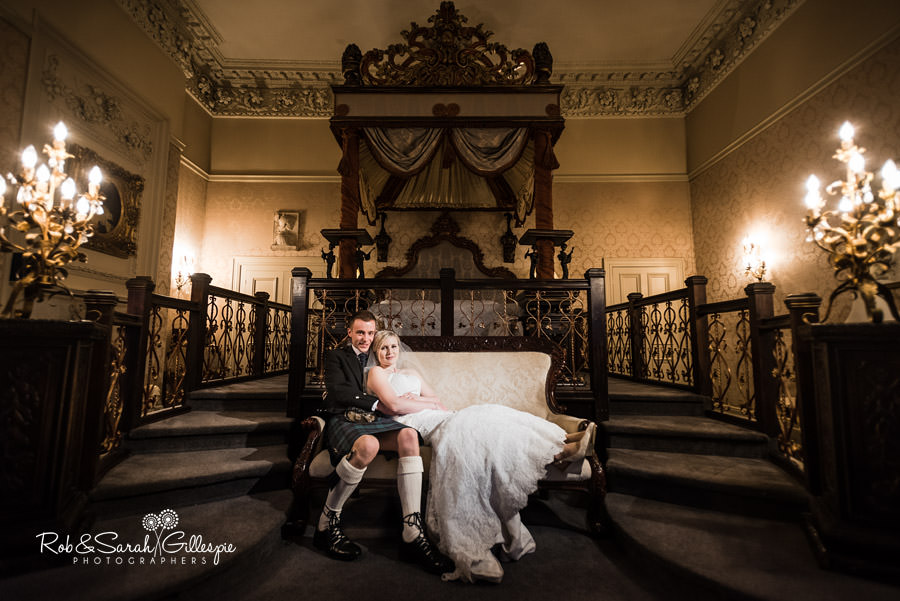 Bride and groom in grand bedroom at Coombe Abbey