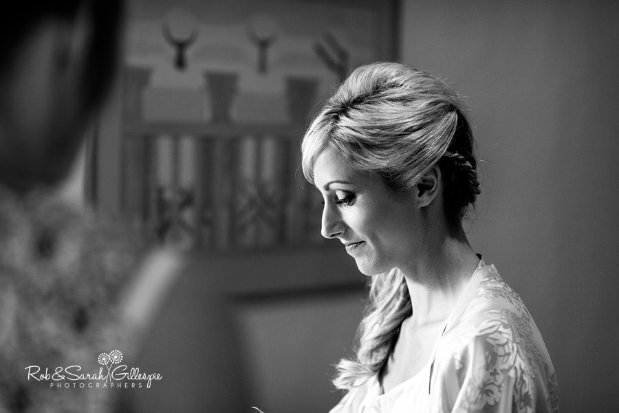 Bride prepares for her wedding at Delbury Hall