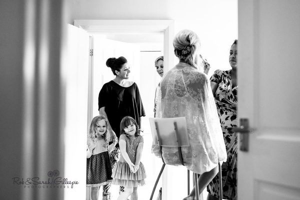 Flowergirls watch bride preparing for wedding at Delbury Hall