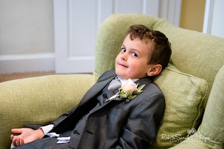 Pageboy pulling funny face