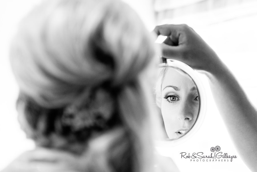 Bride inspecting makeup prior to Delbury Hall wedding