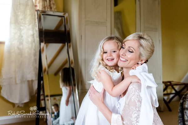 Flowergirl and bride at Delbury Hall wedding