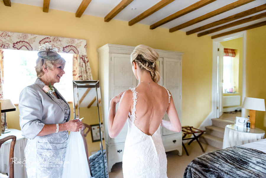 Bride and mother preparing for wedding