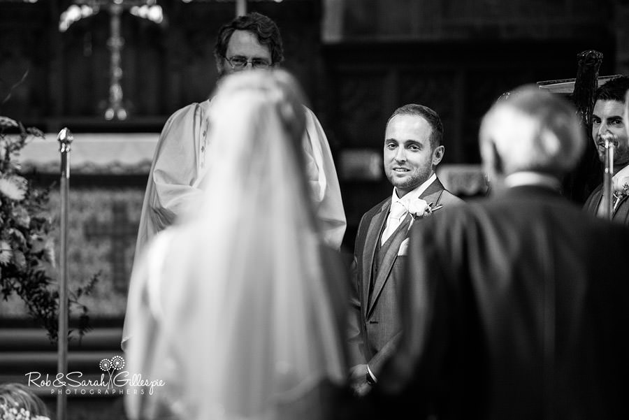 Groom sees bride for the first time at wedding in St Peters Church Diddlebury