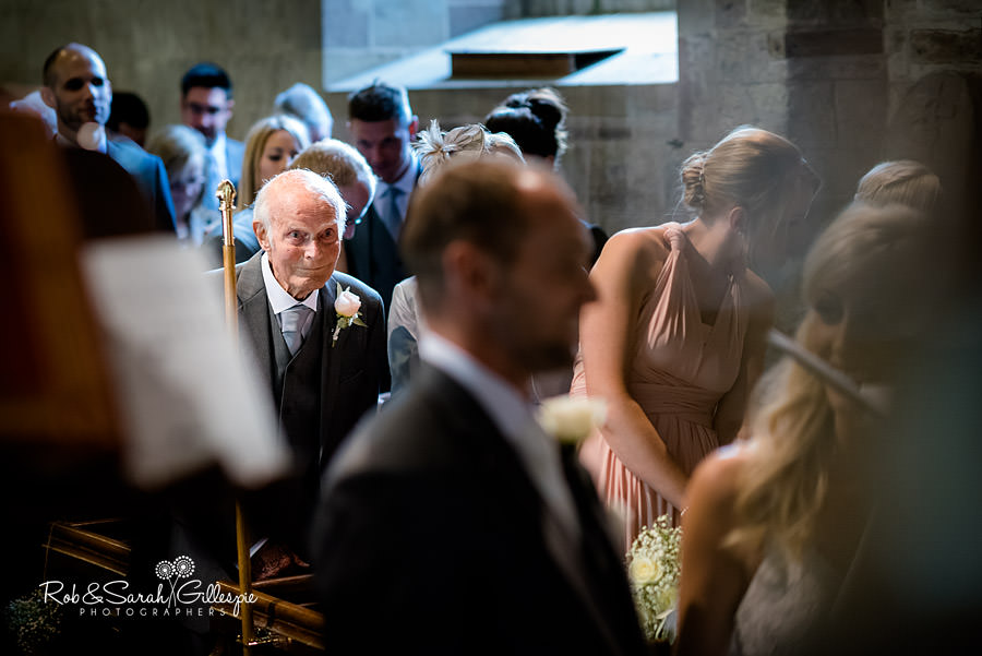 Grandfather looks on as granddaughter gets married in St Peters Church Diddlebury