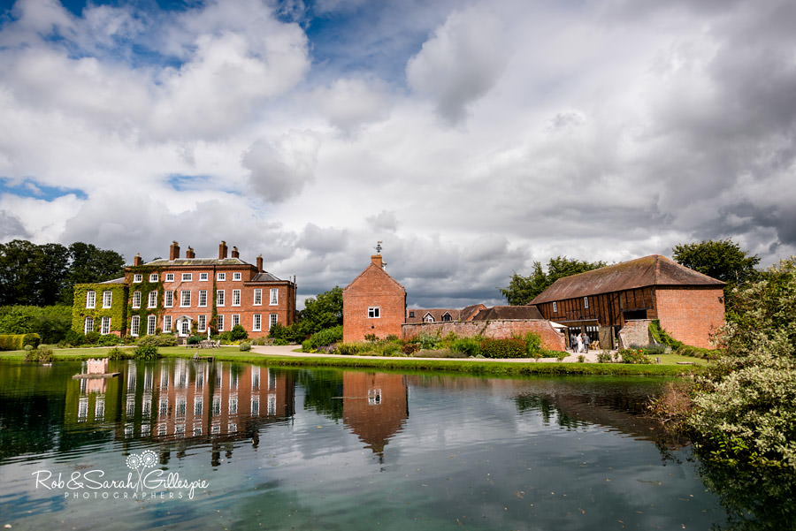Delbury Hall and Coach House in beautiful sunlight with dramatic sky