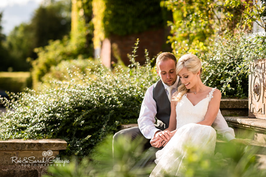 Bride and groom relaxed on the steps of Delbury Hall