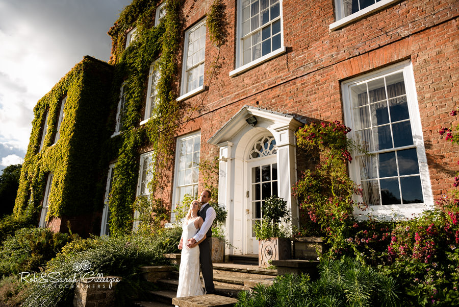 Bride and groom relax in the sunshine at Delbury hall wedding