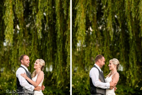 Bride and groom in grounds at Delbury Hall