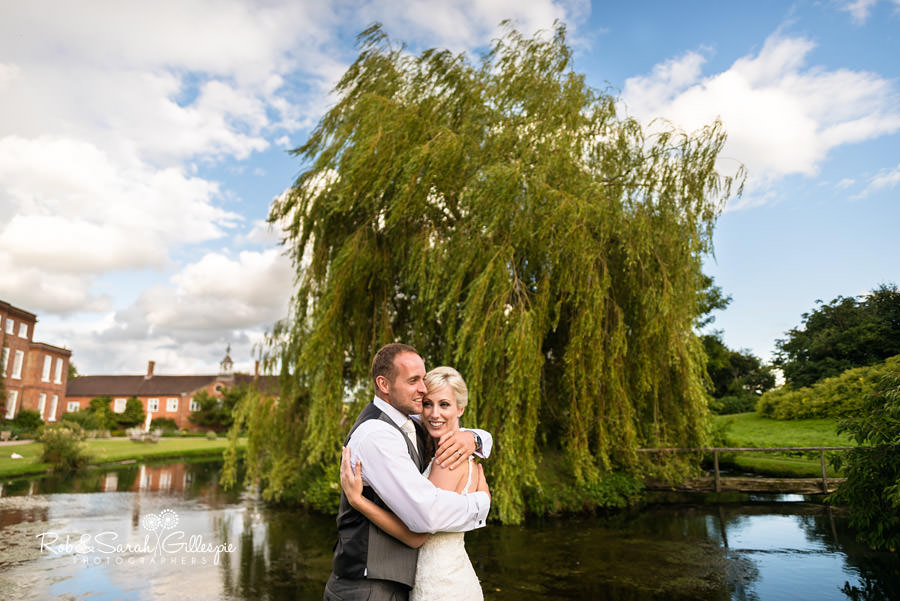 Bride and groom in Delbury Hall grounds