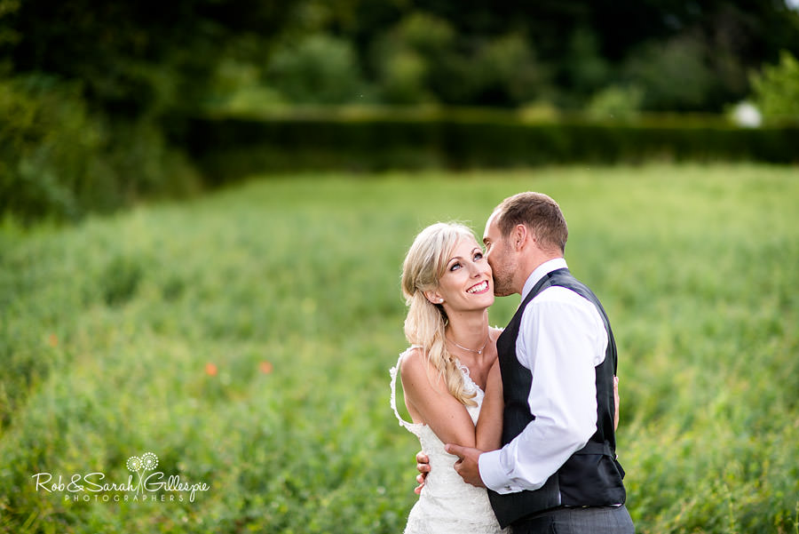 Bride and groom in stunning evening light at Delbury Hall