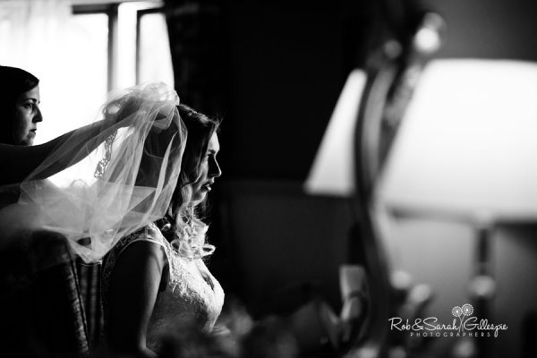 Bride has veil fitted at Coombe Abbey in beautiful window light