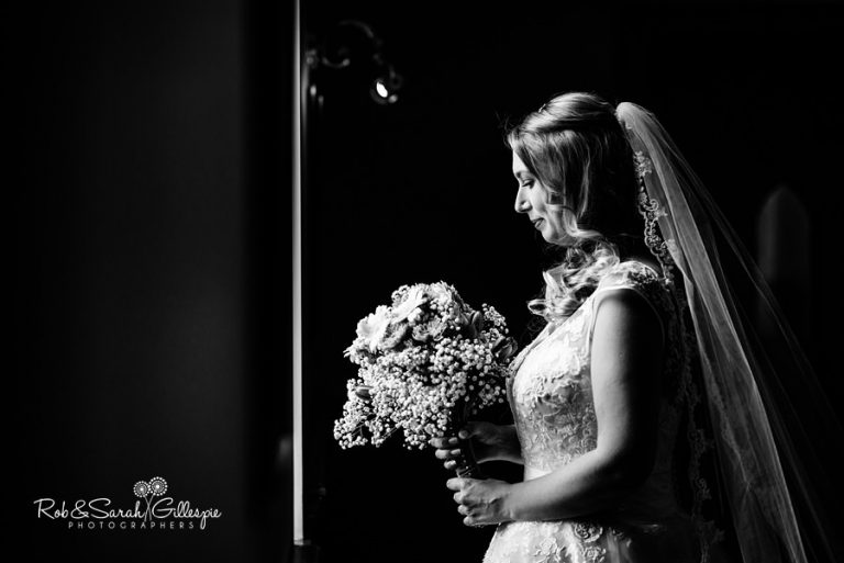 Stunning black and white portrait of bride in window light at Coombe Abbey