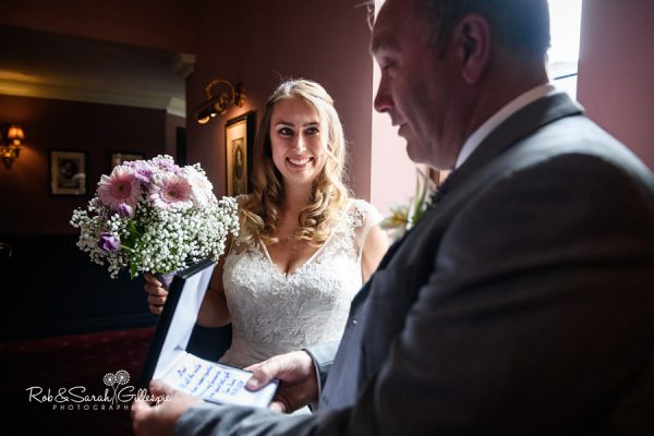 Bride gives father gift at Coombe Abbey wedding