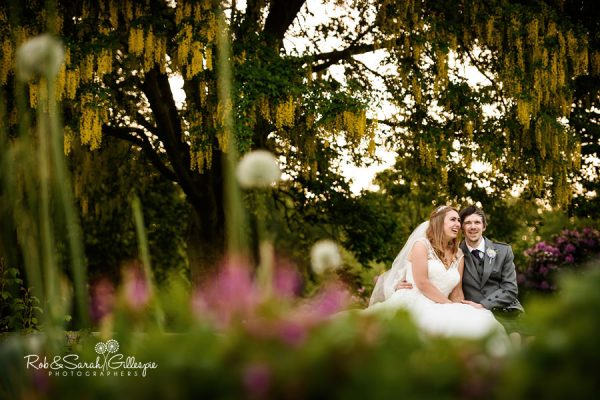 Bride and groom happy and relaxed in Coombe Abbey gardens