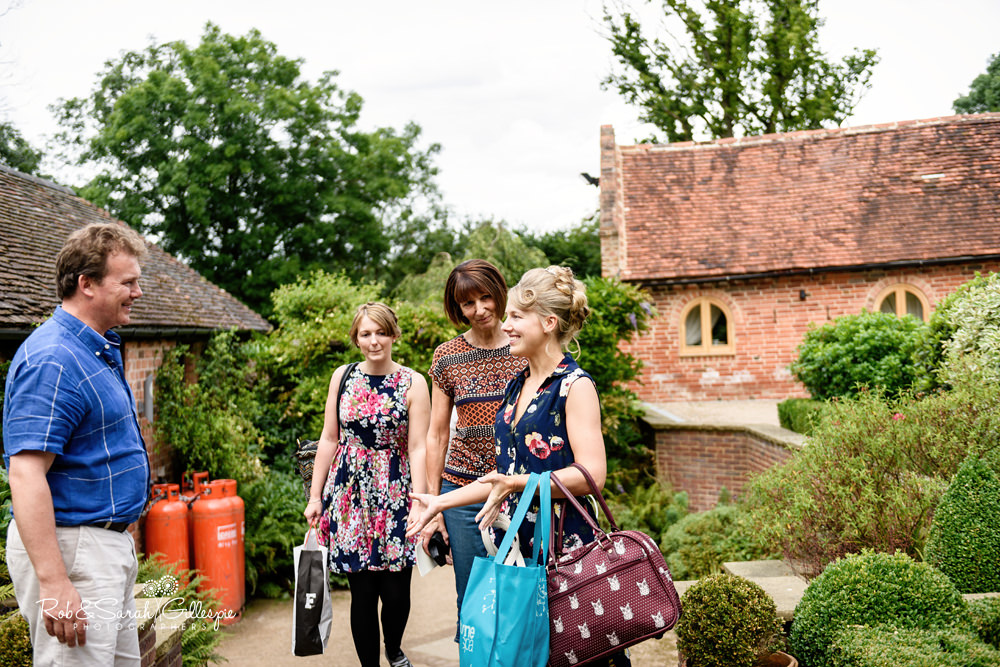 Bride and bridesmaids arrive at Gorcott Hall and chat to manager