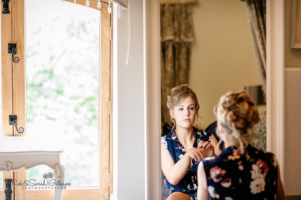 Bride prepares for wedding at Gorcott Hall