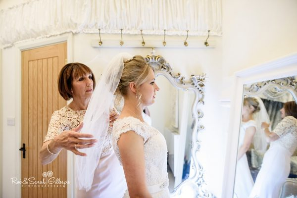 Bride prepares for wedding at Gorcott Hall