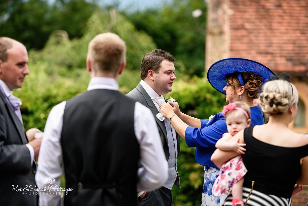 Wedding guests arrive at Gorcott Hall