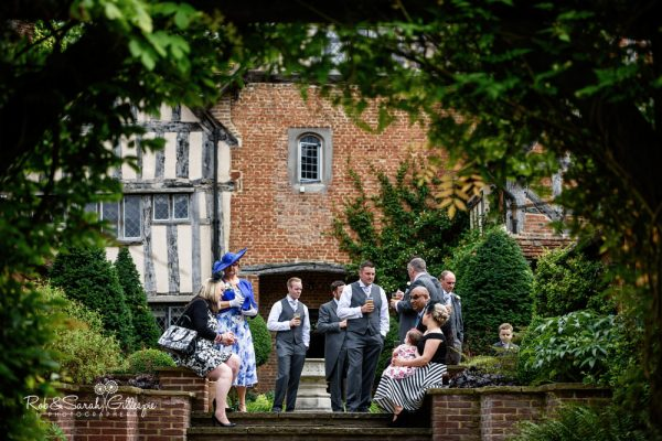 Weddings guests chat at Gorcott Hall