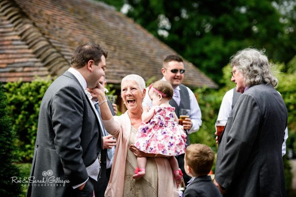 Groom and wedding guests at Gorcott Hall