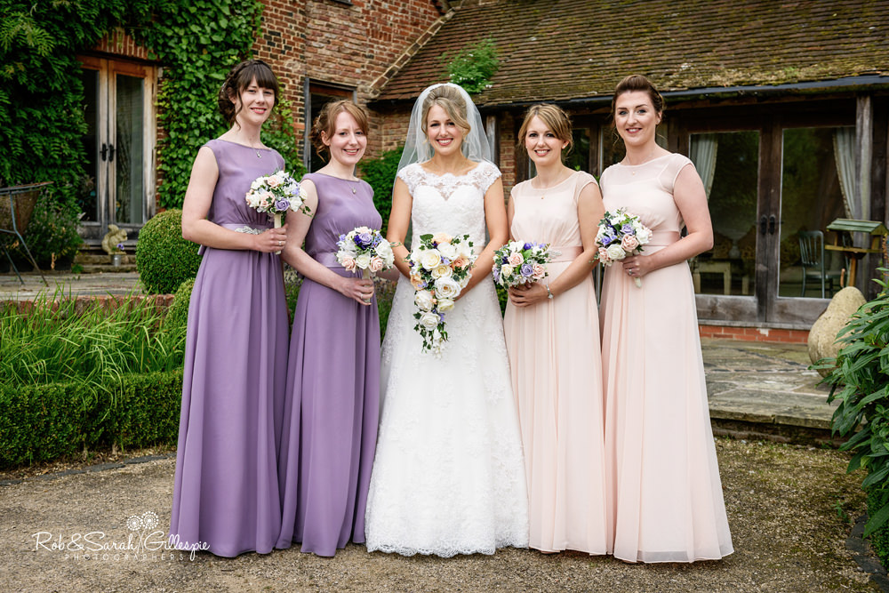 Bride and bridesmaids pose for group photo at Gorcott Hall