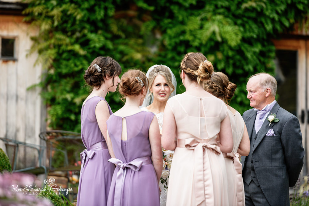 Bride and bridsmaids before wedding at Gorcott Hall