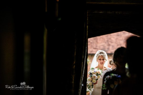 Bride enters Gorcott Hall for wedding ceremony