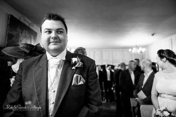 Groom waits nervously for bride at Gorcott Hall wedding ceremony