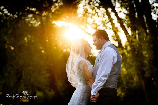 Bride and groom in Gorcott Hall grounds in beautiful light