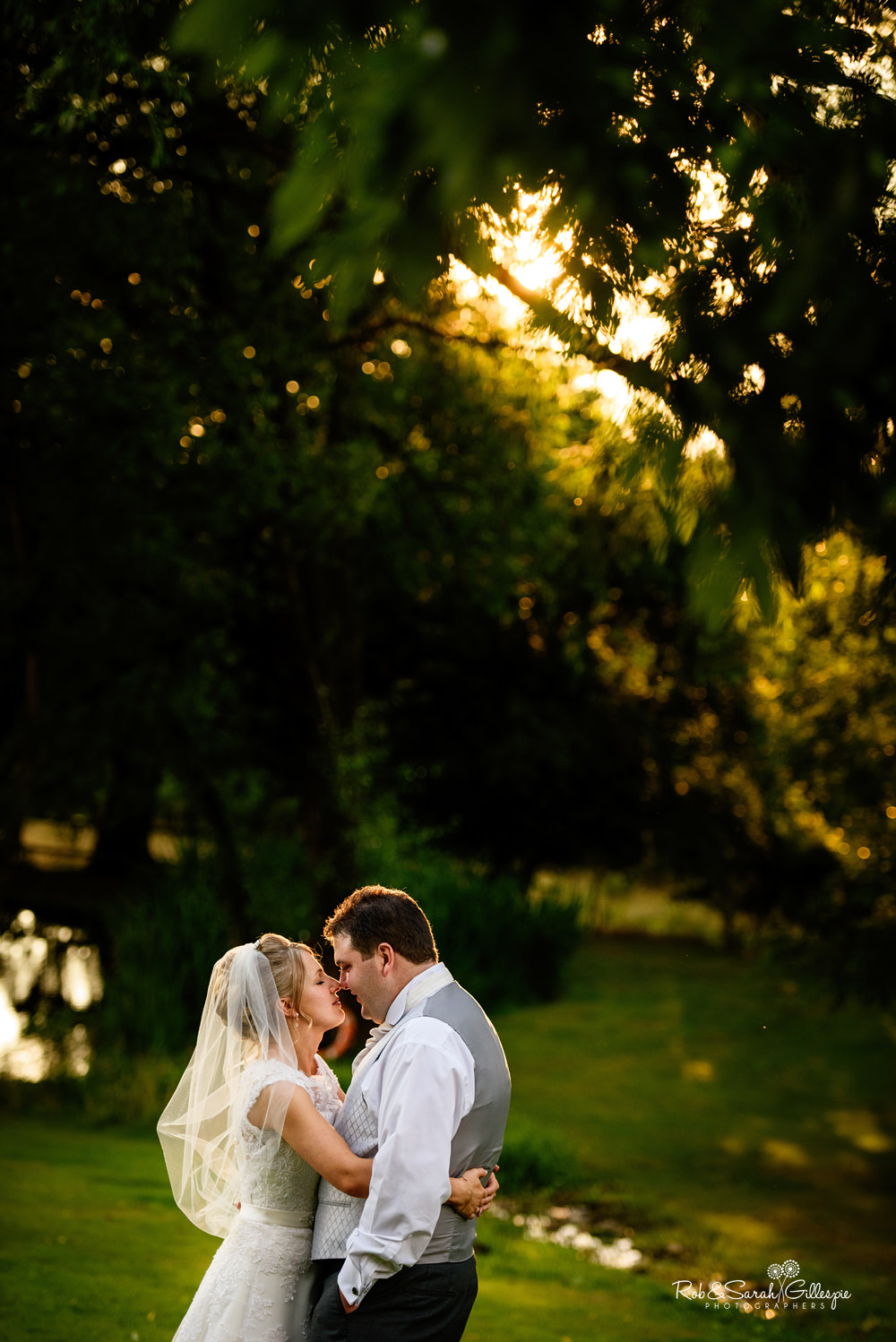 Bride and groom at Gorcott Hall - relaxing in beautiful evening light