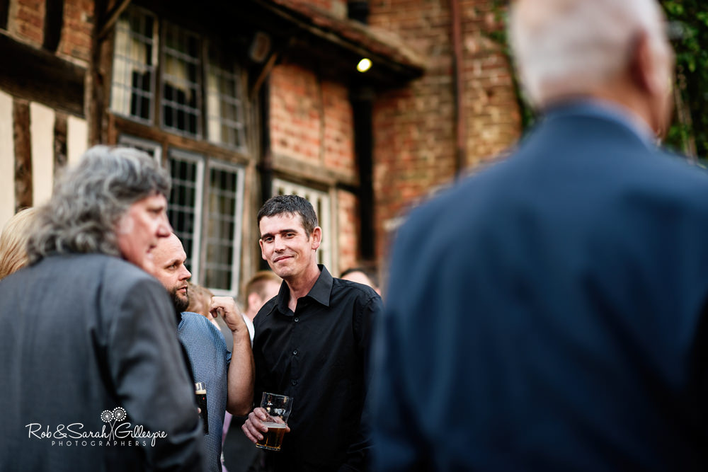 Guests relax at Gorcott Hall wedding reception