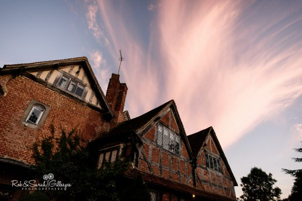Gorcott Hall with dramatic sky
