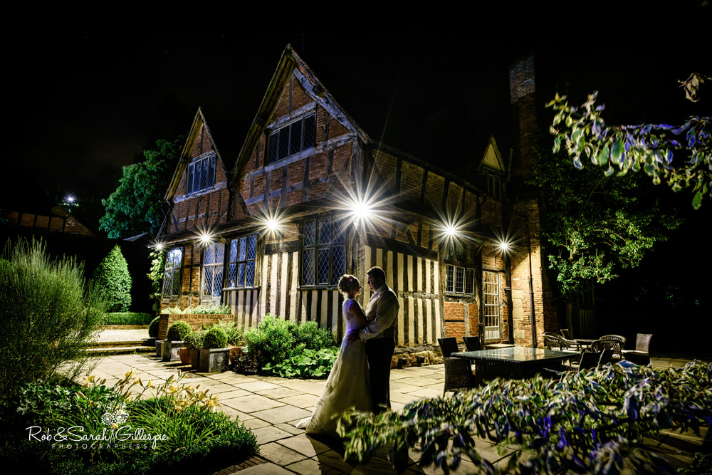Bride and groom in front of Gorcott Hall at night