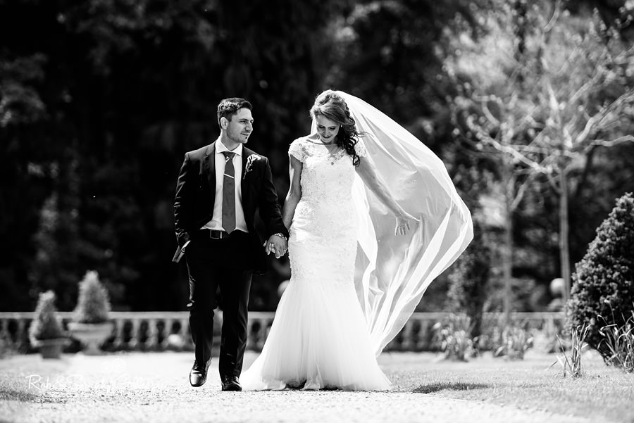 Bride and groom alone in the beautiful grounds at Hogarths