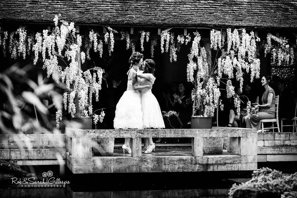 Brides kiss at end of same-sex wedding ceremony at the Matara Centre